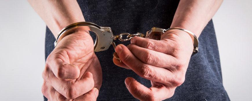 hands-in-handcuffs-1462608479r21-2